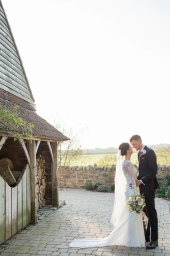 bride and room outside their wedding barn