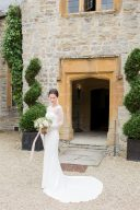 bridal portrait wearing an elegant lace wedding dress at almonry barn
