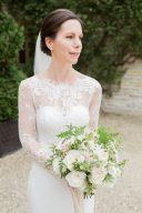 elegant bride with timeless lace gown holding her bouquet