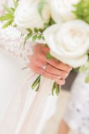 bride holding her bouquet showing engagement rign