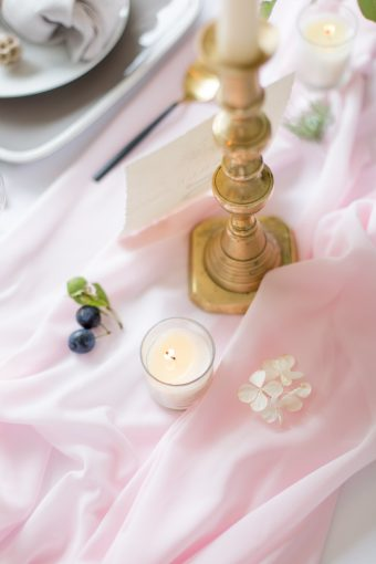 blush pink silk table runner and tealight candles