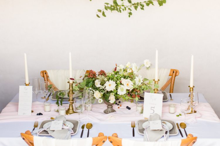 romantic wedding table decor ideas with modern floral centrepiece and blush pink silk runner