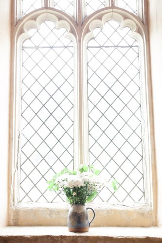 church window details and flowers at wedding