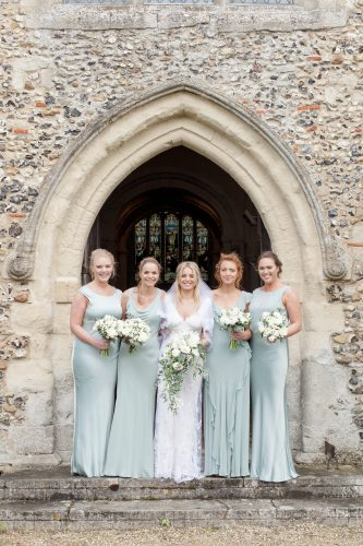 bride and her bridesmaids in matching pastel turquoise dresses