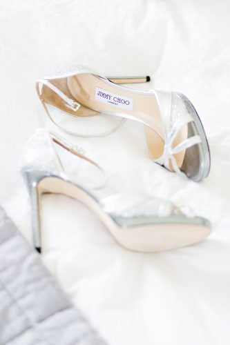 the bride's silver jimmy choo shoes