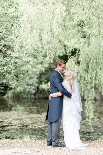 bride and groom portrait under weeping willow tree