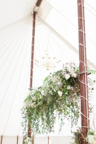 suspended floral installation in green and white for marquee wedding