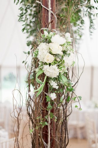 floral design to cover marquee poles