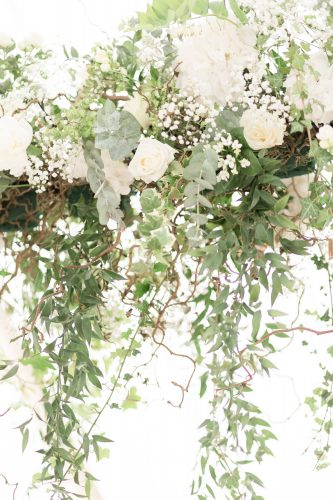 foliage and rose floral installation for wedding marquee