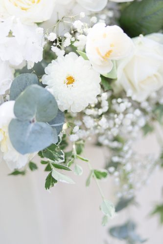 green and white wedding flowers with flourishes of eucalyptus