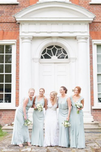 happy smiling bridesmaids portrait wearing pastel turquoise dresses