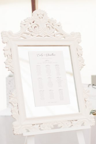 white framed wedding seating plan