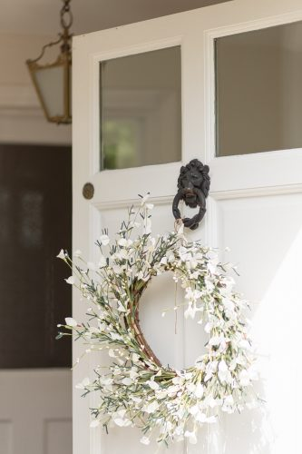 white cottage door with spring wreath