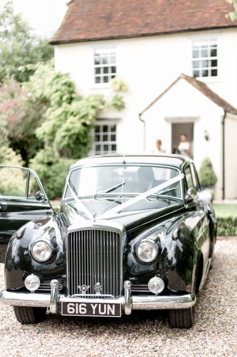 timeless elegant black wedding car
