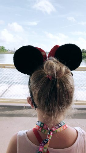 arriving at disney world wearing minnie mouse ears