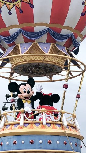 mickey mouse in a hot air balloon float at the street parade disney world florida