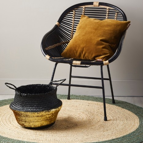 black and gold seagrass storage basket