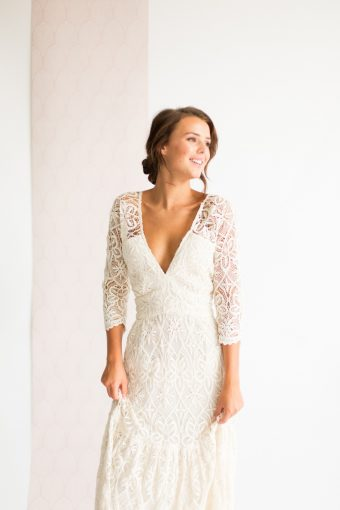 bridal portrait wearing a modern lace wedding dress with low v neckline