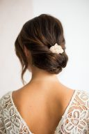 modern bridal hair in a low chignon and accessory