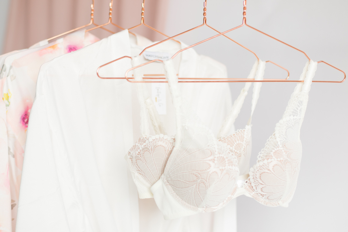 wonderbra bridal collection hung on stylish copper wire hangers