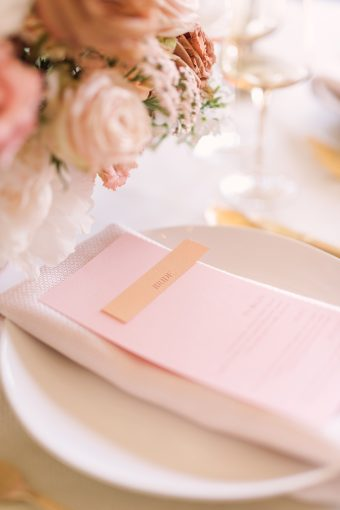 pink and gold place setting with modern stationery