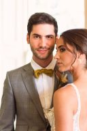 classic groomswear with mustard bow-tie