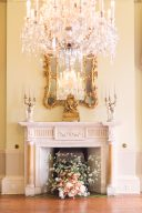 classic fireplace wedding floral arranegement