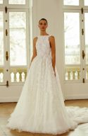 wedding dress covered with embroidered flowers by Dana Harel