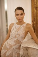 wedding dress with sheer bodice and sparkly embellishments by Dana Harel