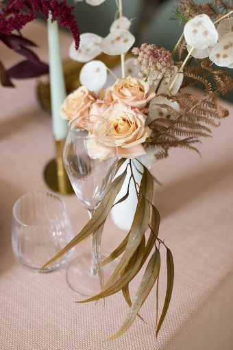 peach roses and palm leaf floral arrangement