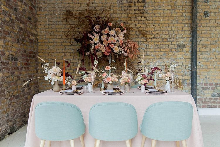 industrial wedding styling with sage green chairs