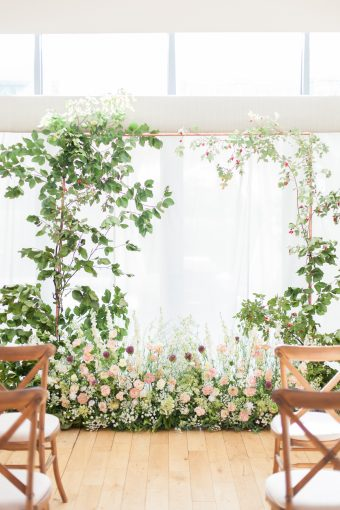 intimate wedding ceremony floral arch