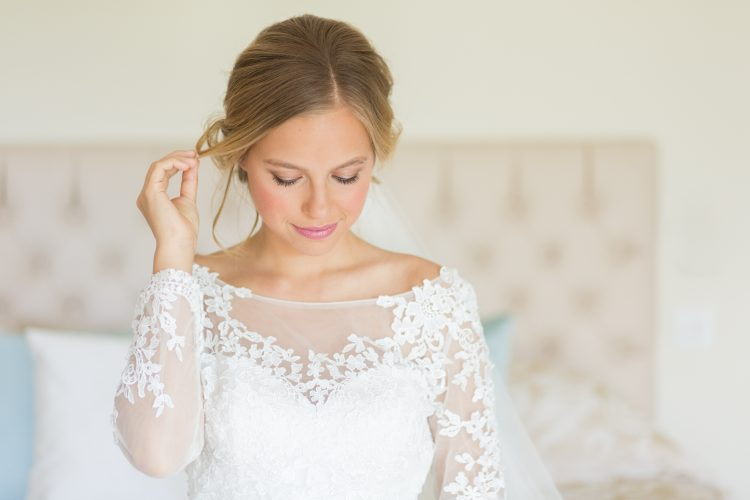 bride wearing illusion neckline wedding dress with lace sleeves by Stelfox Bride