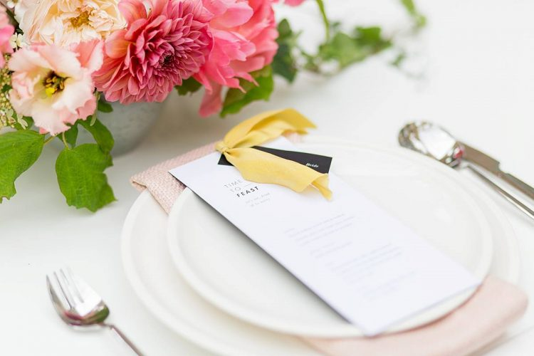 tropical pink yellow and black place setting with vibrant pink peonies