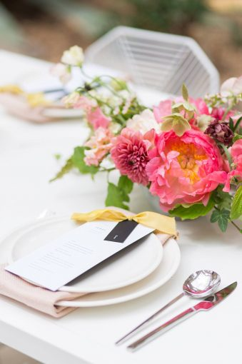 tropical place setting with pink and yellow