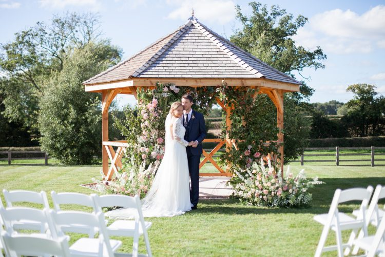 outdoor ceremony pavilion with floral arch