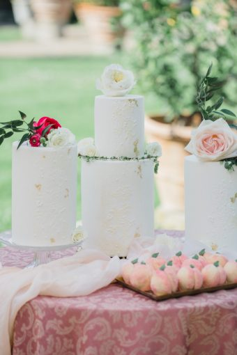 trio of cakes with pink flowers
