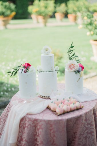 trio of wedding cakes with pink florals