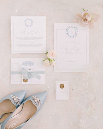pastel blue monogram wedding stationery with something blue wedding shoes
