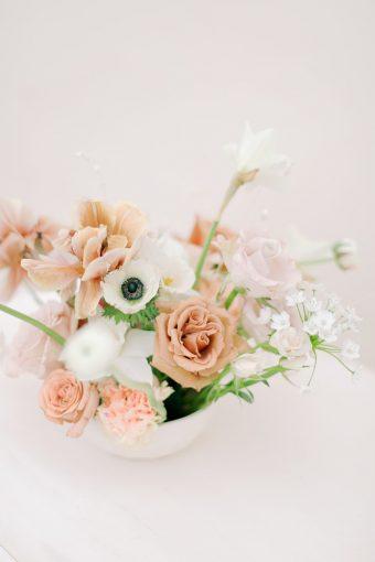 peach and orange spring floral arrangement with anemones and ranunculus
