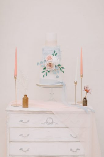 pastel blue and blush wedding floral cake with candles