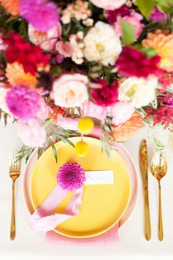 how to plan a colourful wedding with yellow and pink place settings and vibrant modern flower arrangements