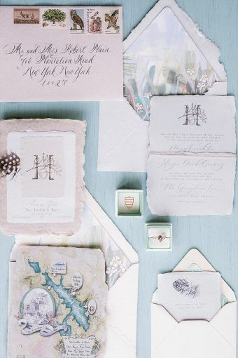 powder blue artisan wedding stationery with handpainted details