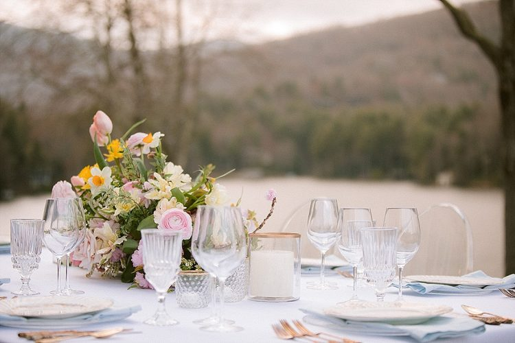 table setting with pink and yellow spring flowers, vintage tableware and gold cutlery, handpainted menu