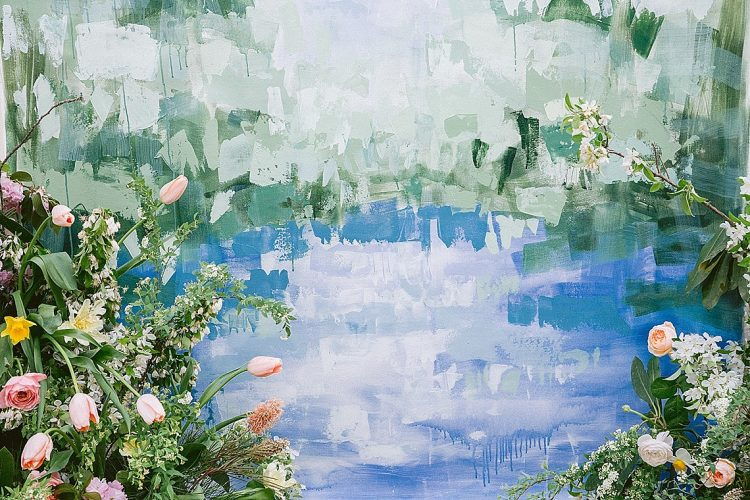 hand painted blue and green wedding ceremony backdrop with spring flowers and tulips