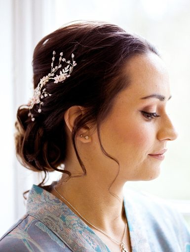 soft romantic bridal makeup and updo with gold pearl hair vine