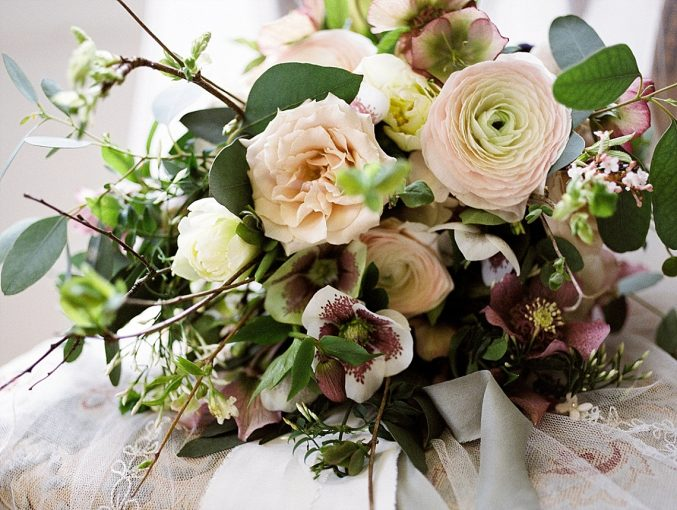 chinoiserie inspired wedding bouquet with quince, hellebore, ranunculus, blossom, roses, willow and tulips
