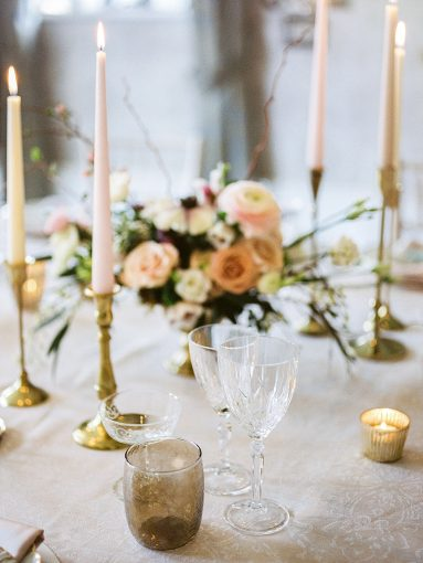 chinoiserie inspired wedding place setting with gold candlesticks