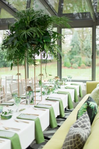 green wedding table styling with tall foliage arrangements
