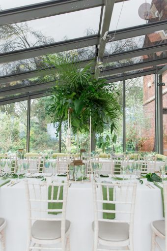 tall greenery arrangements with palm leaves and fern